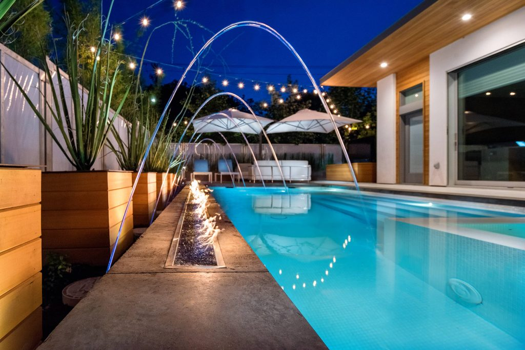 The flawless execution of a sophisticated modern luxury pool design requires planning and coordination.