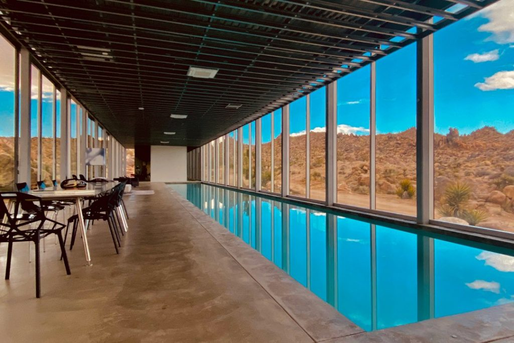 Beautiful 100 foot long indoor pool - Invisible House at Joshua Tree, CA.