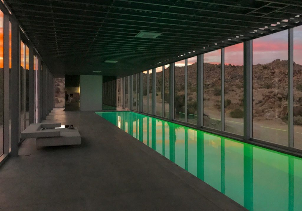 Colored led lighting makes this gorgeous indoor pool come alive.