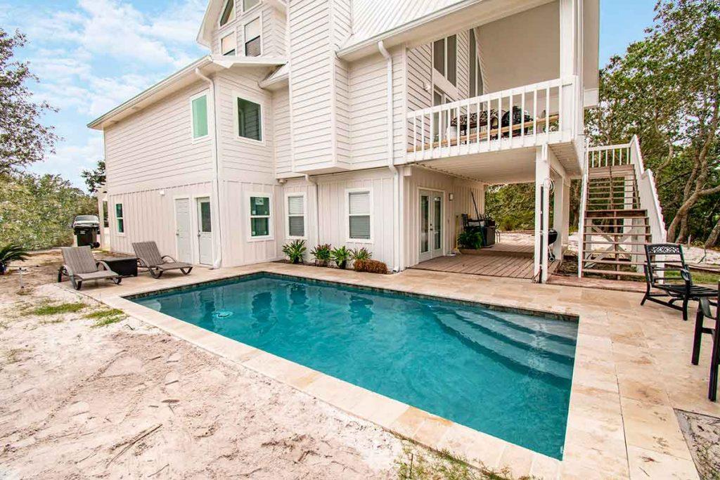 Simple and elegant outdoor pool patio design