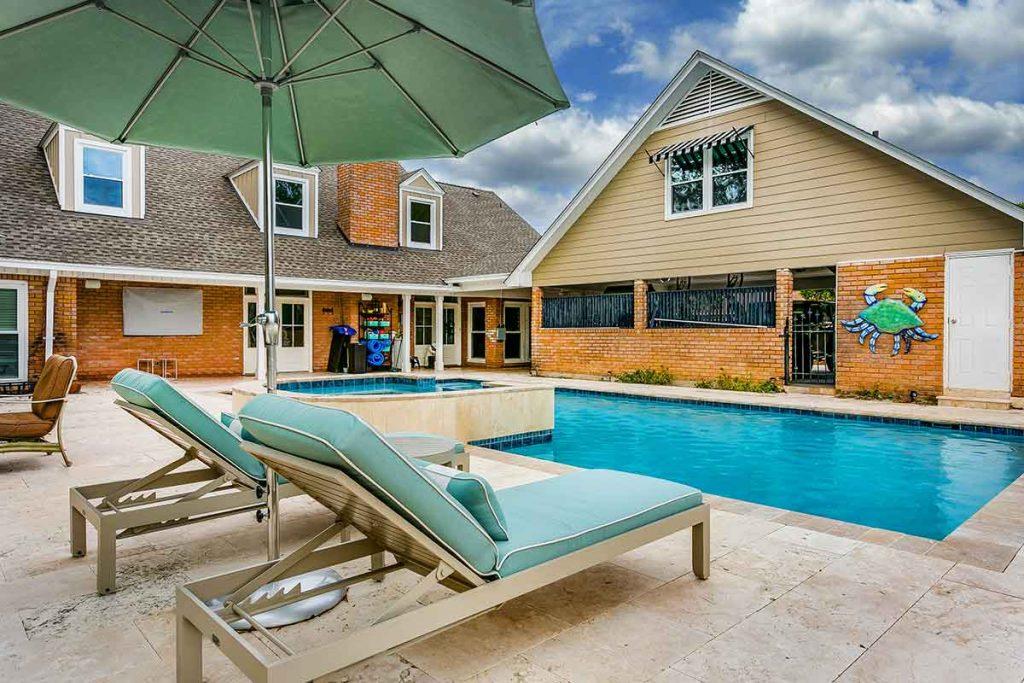 Beach resort pool design with raised spa