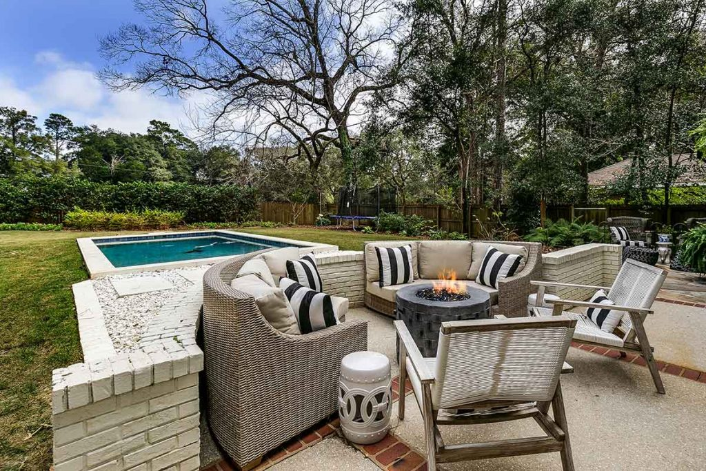A firepit conversation area by the pool is a classic design.