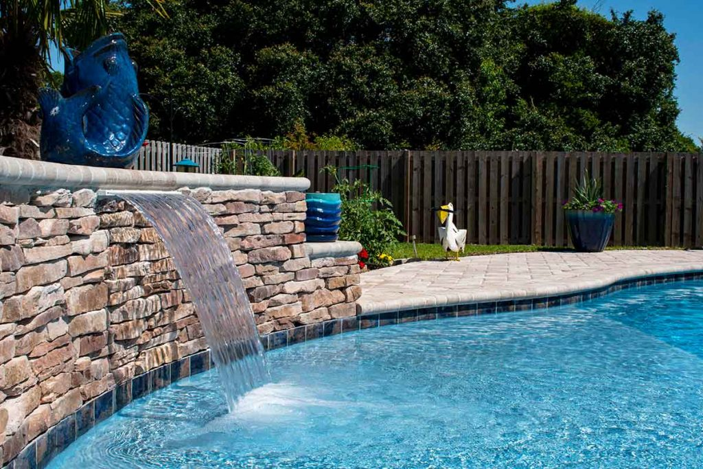Pool elevations with retaining walls are a high end feature homeowners love.