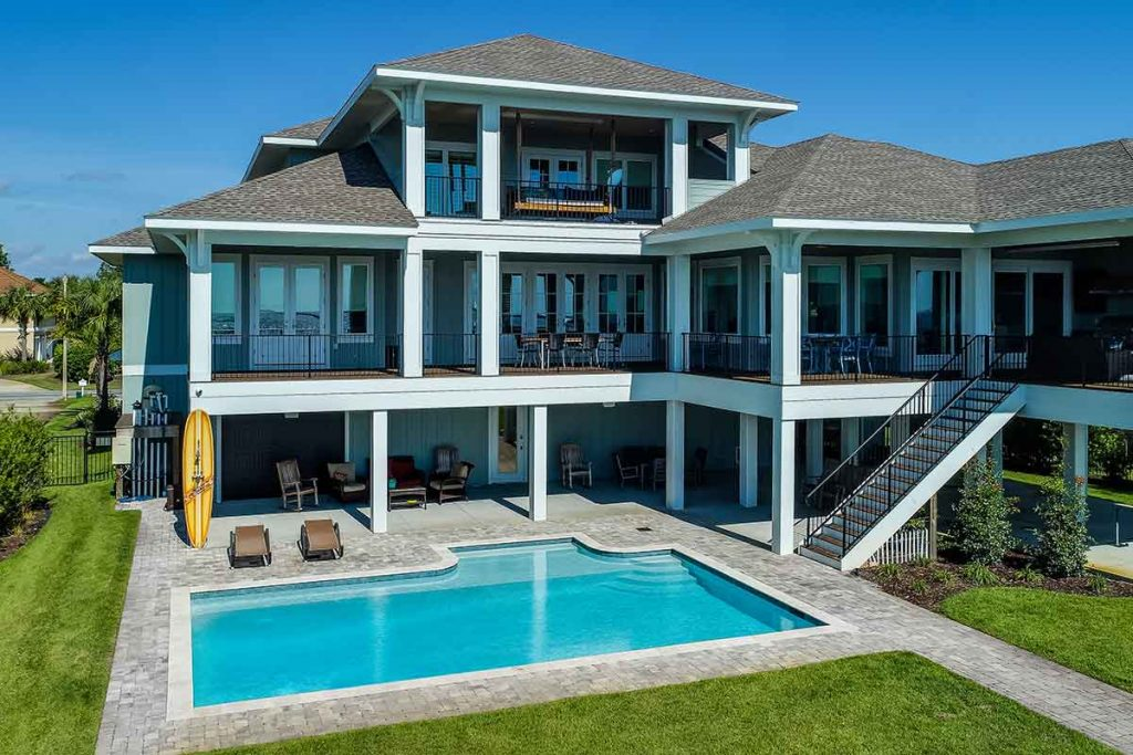 Mansion pool with covered seating areas on multiple levels.