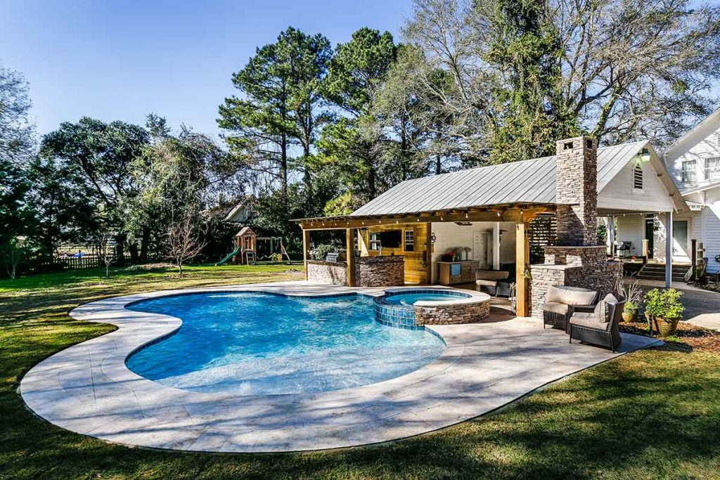 Picture perfect backyard with swimming pool.