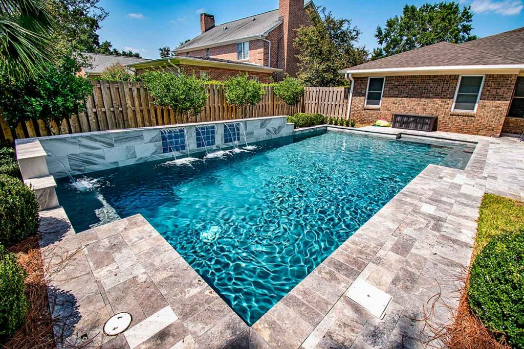 Luxury inground pool with sheer descents - retaining wall