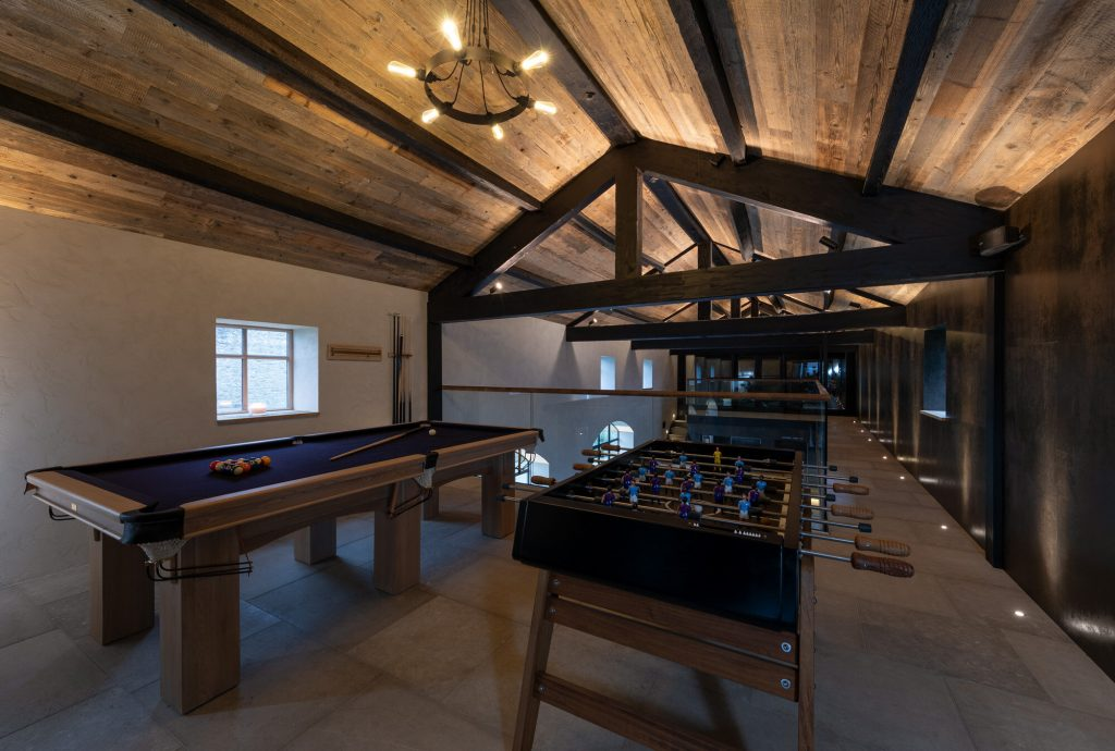 An upstairs gaming area is located directly above the swimming area.
