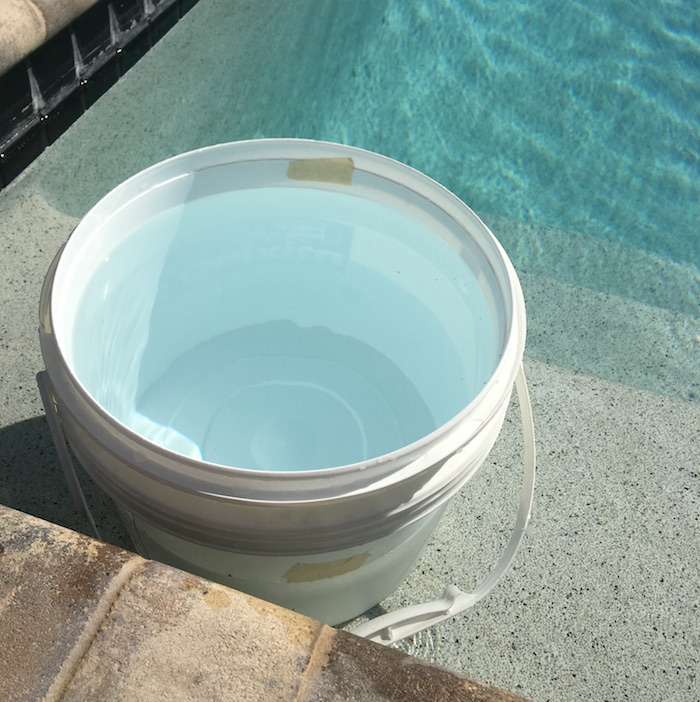 The bucket test is a reliable method of determining whether you have a pool leak. - Photo Credit: Pinch A Penny
