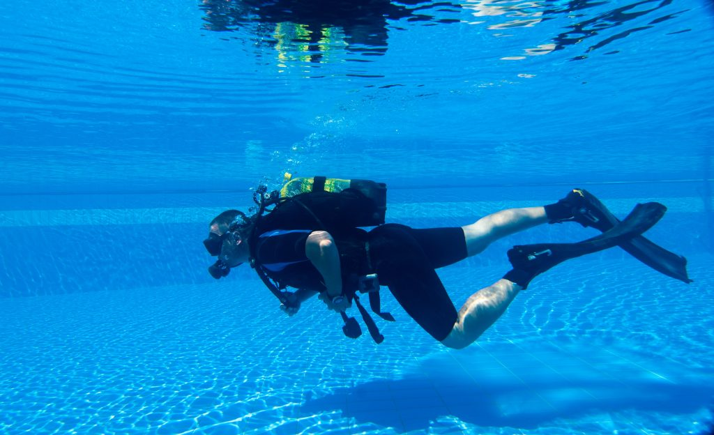 Pool Leak Detection Being Conducted With Scuba Gear