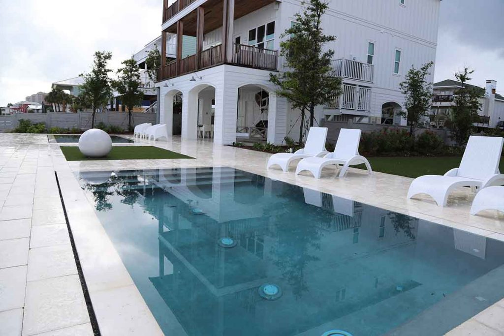 Perimeter overflow pool designs create the aesthetic where the pool becomes a sheet of glass.