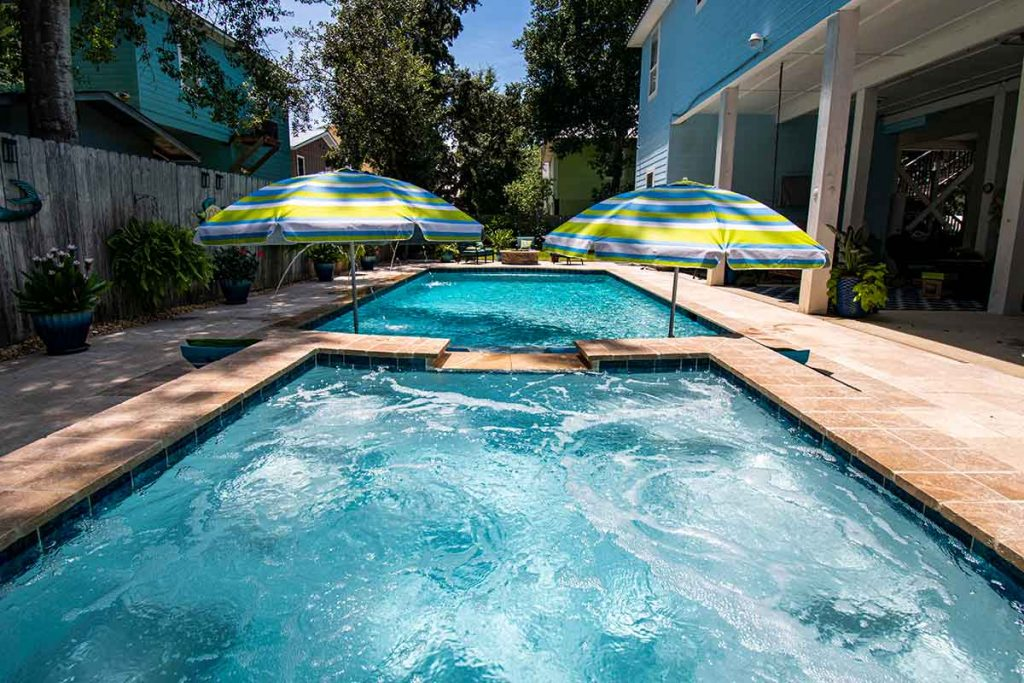 Popular Pool Features - Raised Spillover Spa offers a complete overview of the pool area.