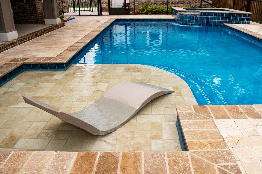 Adding a ledge lounger to a pool is easy and a beautiful design aesthetic.