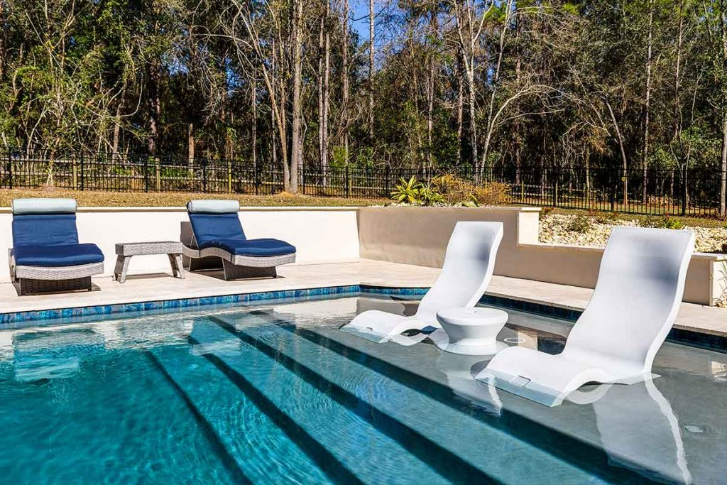 Create seating for guests to lounge poolside and for swimmers to enjoy as well.