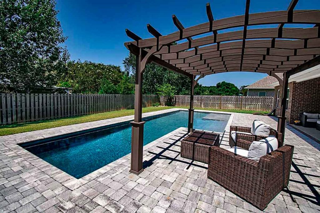 It's amazing what a pergola can do to pull the entire pool design together and make the backyard feel complete.