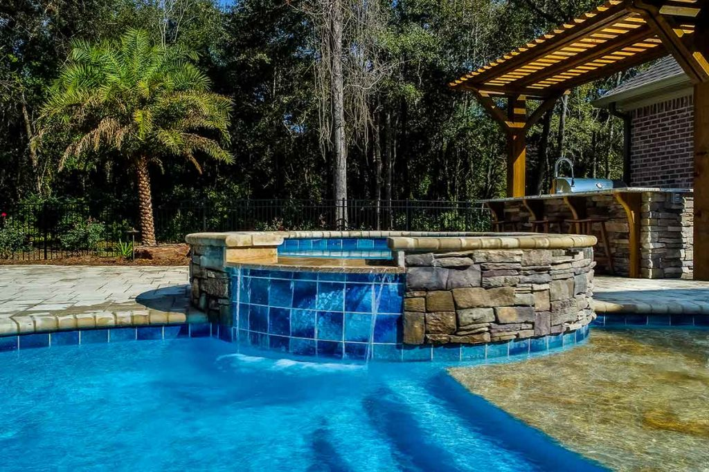 Raised spa with large format tile has a seamless tile line above the waterline.
