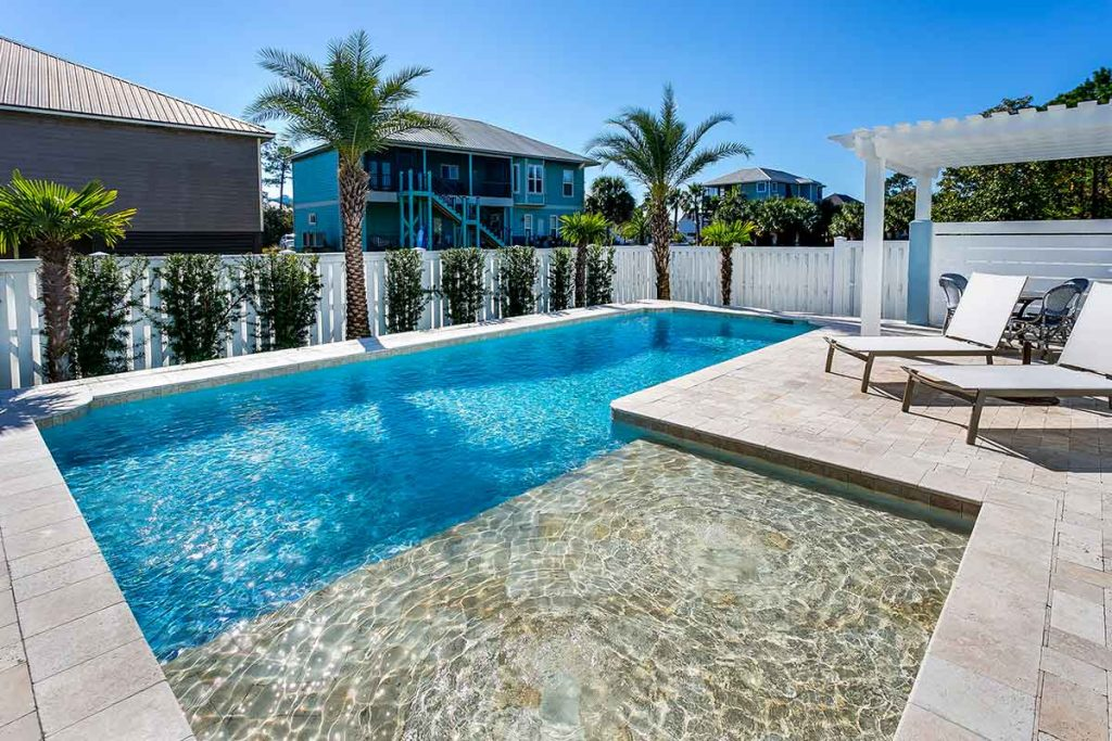Massive tanning ledges create an expanded shallow area for younger swimmers.