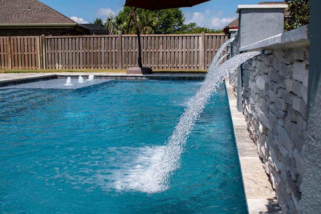 Smart use of retaining walls means incorporating water features.